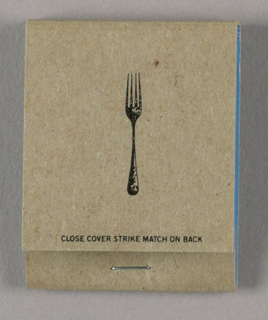 On brown, uncoated paper, a printed image in black ink of a fork; interior blue coated paper.