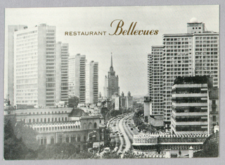 Recto: The entire space is occupied by a cityscape skyline photograph, comprising nineteenth and twentieth century buildings. A curved roadway in the center divides left and right.  Verso: On the left are six lines of type, beginning Reggie Young and Florent Morellet, concerning the opening of Restaurant Bellevues. A crossed knife and fork and an additional line of type appear below. The owners' and restaurant's names are in script; the additional informational is in small capital type.