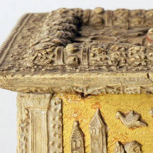 A gilt wood and metal casket depicting a scene. Oblong box with projecting base and cover, four flattened ball feet, and rosette and round knob-sides and cover gilt and punch-marked.  Moulded and carved reliefs representing on front the Calydonian Boar Hunt; on back, the Judgment of Paris; on sides, the Baptism of the Samarians by Philip and Judith.  On cover, two pairs of winged genii holding wreaths.  Pilasters on corners, acanthus moulding on base and lower part of cover.  Moulding with oak leaves on cover, which is hinged to body with simple eyelet hinges.  Part of snap lock on front--corresponding part on cover missing.