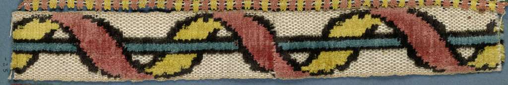 Trimming fragment in an alternating red and yellow leaf pattern that passes over and under a blue bar on a cream-colored ground.