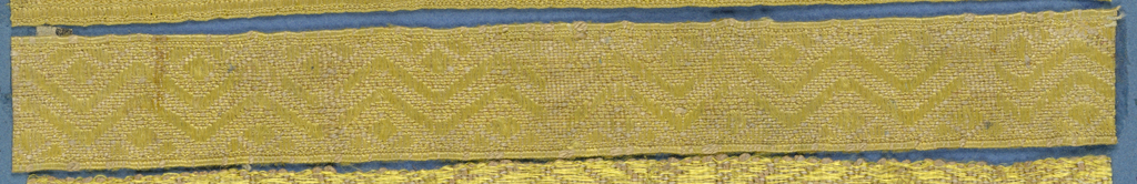 Yellow trimming fragment in a design of zigzag lines.
