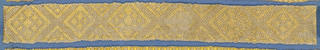 Pink, yellow and white trimming fragment in a design of ornamented lozenges separated by spaces.