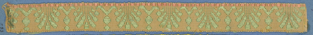 Green, brown and tan trimming fragment in a design of leaf forms with one border of blocks.