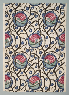 Mottled gray ground fabric has alternating rows of circles that contain small scenes of green hills, green and pink palm trees, and a pale pink sky. Black serpentine branches with small blue flowers meander around the circles.  Pattern matches side to side.