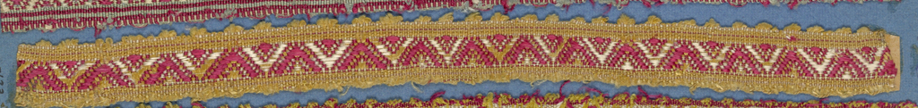 Trimming fragment in a design of red and white chevrons on a yellow ground; picot edges.