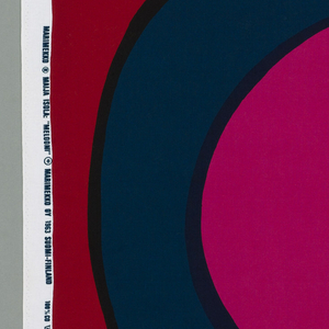 Length of printed cotton with a very large-scale design of concentric ovals in orange, fuchsia, black and purple on a red ground.
