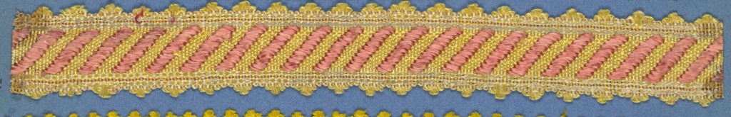 Trimming fragment in a design of diagonal rose bands on a yellow ground; picot edges.