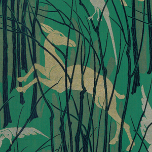 A pattern of gold gazelles and silver birds in a forest of blue trees on a green background.