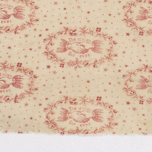 """Printed cotton with a repeating design of two clasped hands with the words """"The Union Forever"""" surrouned by a wreath of flowers, on a ground sprinkled with stars. Printed in red on a white ground. The Union Forever was printed for Abraham Lincoln's second Presidential campaign in 1864."""