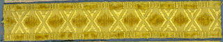 Yellow trimming fragment in a design of lozenges in cut velvet separated by large X-shaped motifs. Borders in cut and uncut velvet.