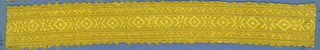 Yellow trimming fragment in a design of crosses alternating with lozenges between borders in a chevron pattern; picot edges.