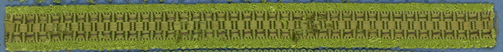 Green trimming fragment in a checkboard design.