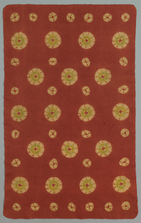 Rectangular rug made of wool which is felted, then patterned with  tied resist dyeing, leaving large and small dots of yellow in a deep red-orange ground. Touches of green applied by brush. A mosen is a type of rug used in Japanese tea ceremonies.
