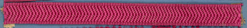 Red and tan trimming fragment in a checkerboard pattern.