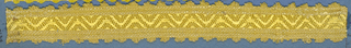 Yellow trimming fragment in a design of a zigzag between straight borders; picot edges.