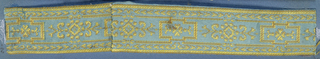 Trimming fragment in a design of a Greek motif in yellow on a blue ground.
