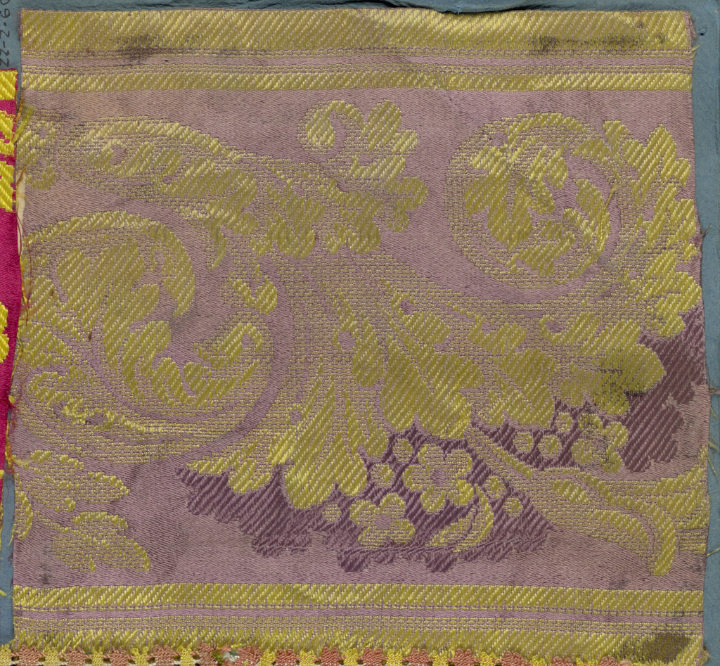 Trimming fragment in a design of yellow scrolling leaves on a purple ground.