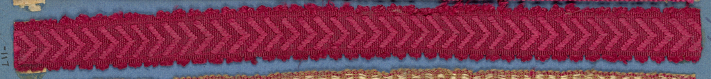 Red trimming fragment in a chevron pattern; picot edges.