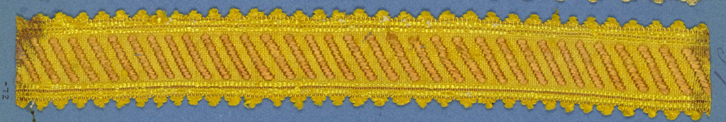 Trimming fragment with a design of diagonal brown bands on a yellow ground; picot edges.
