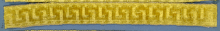 Yellow trimming fragment in a design of a Greek key motif.