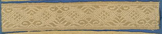 Pink trimming fragment in a design of ornamented lozenges with scrolls and leaf forms.