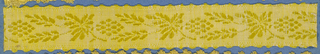 Yellow trimming fragment in a design of a grape vine with leaves and fruit.
