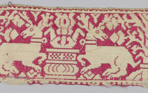 Narrow band of linen, twill weave with pattern in red silk of confronted stags on either side of a fountain.