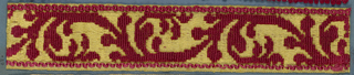 Trimming fragment in a design of an angular stem with leaves in uncut red velvet on a yellow satin ground.
