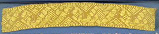 Yellow and pink trimming fragment in a design of an ornamented zigzag band.