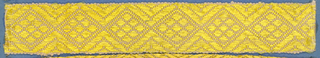 Yellow and pink trimming fragment in a design of lozenges ornamented with smaller lozenges.