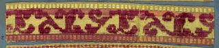 Trimming fragment in a design of an angular stem with leaves in uncut red velvet on a yellow satin ground. One border is yellow, and the other is red.