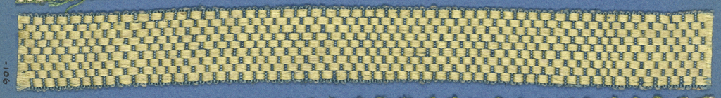 Blue and yellow trimming fragment in a checkerboard design.