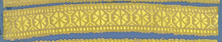 Yellow trimming fragment in a design of eight-petal flowers separated by linear motifs; picot edges.