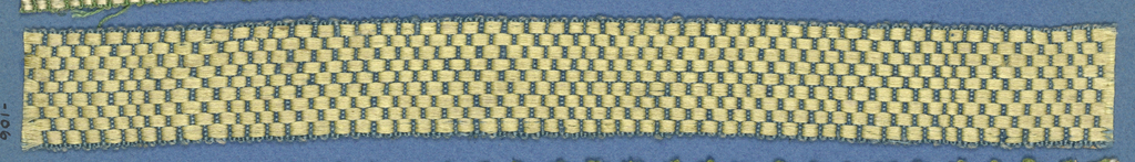 Trimming fragment with tan and green diagonal lines arranged to form chevrons on a white ground; picot edges.