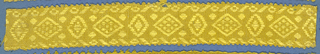 Yellow trimming fragment in a design of lozenges, placed horizontally and vertically between borders; picot edges.