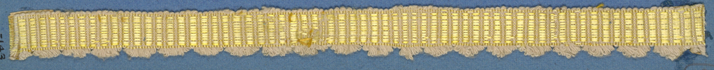 Trimming fragment in a design of alternating pink and yellow stripes; one picot edge.