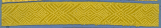 Yellow trimming fragment in a design of alternating motifs composed of three large lozenges and one small.