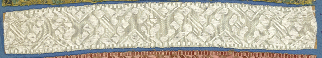 White trimming fragment in a design of an ornamented zigzag band.