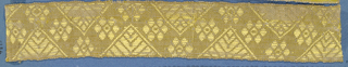 Yellow trimming fragment in a design of a zigzag band ornamented with open flowers and triangular leaf forms.