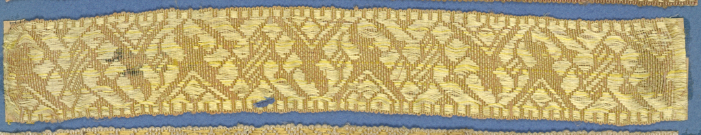 Pink and yellow trimming fragment in a design of an ornamented zigzag band.