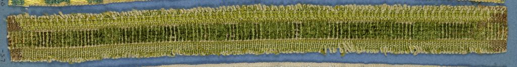 Green trimming fragment with a central band in squares of cut and uncut velvet.