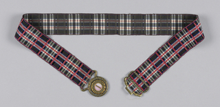 Black, white, pink and blue plaid ribbon with a clasp of silvered brass and a pink and white shell ornament.