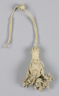 White linen braided cord terminating in a pear-shaped form from which hang six units of braided and knotted threads.