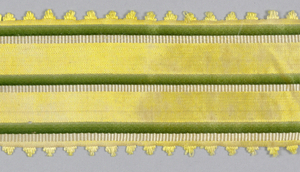Yellow ribbon with narrow green and white stripes and scalloped picot edge.
