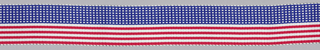 Woven ribbon made for the American Bicentennial. Ribbon is divided into two halves: one with red and white stripes, the other with blue and white squares.