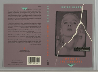"Printed front cover design with a purple background that includes a photographic reproduction of a woman with short hair facing forwards, with her head slightly upturned. Above the image, ""KATHY ACKER"" appears in green, and below, the title ""EMPIRE OF THE SENSELESS"" appears in orange, with the subtitle, ""a novel"" printed in black inside an upside down green triangle at the bottom. Traveling from the top to the bottom of the front cover is a simulation of a tear in white. A quote praising the book appears on the lower right in white printed text inside a black box. The spine is also purple and shows the author's name in green and the book's title in orange, both printed vertically, as well as Grove Press's colophon in black at the bottom. The back cover includes information about the book, including the price ($9.95), printed in black against a purple background. The first letter, ""S,"" is contained within an upside down green triangle, and a small orange symbol that appears to reference book pages being turned, appears towards the bottom of the design above the black text, ""AN EVERGREEN BOOK / Published by Grove Press."" A white block containing a bar code and ISBN number printed in black is in the lower right corner of the back cover."