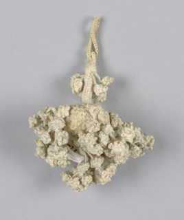 Tiny linen tassel, braided and knotted. Braided loop and stem attached to center ball to which are attached six units made of small knots (including center).