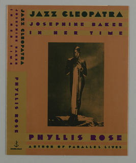 Book jacket design for Jazz Cleopatra. On orange-brown ground, a one-toned black photograph of the figure of Josephine Baker. She appears nude, holding her hands to her chest, with long chains of pearls wrapped around her hands and dangling down the length of her body. She also holds a length of fabric, possibly a dress. She wears makeup and large earrings and stands in an abstract rocky landscape. Stylized text above, below, and at the spine in black and purple. Doubleday colophon appears at lower left, a dolphin curved around an anchor.