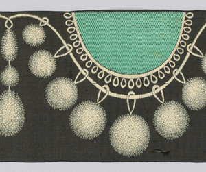 Green ribbon showing a design of black tassels and cords looped in half ovals along the top edge.