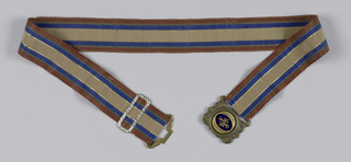 Brown, blue and gray striped ribbon belt with a silvered brass clasp and blue paste ornament.